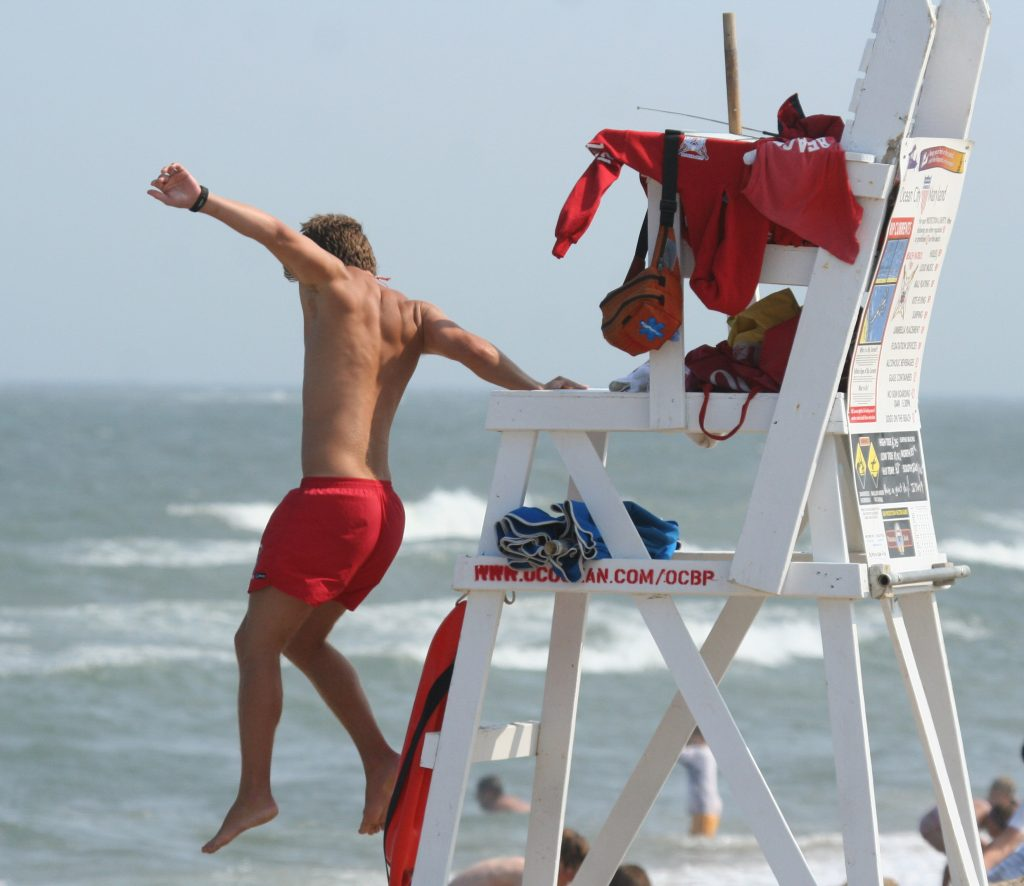 Lifeguard_jumping_into_action,_Ocean_City,_June_27_,2007