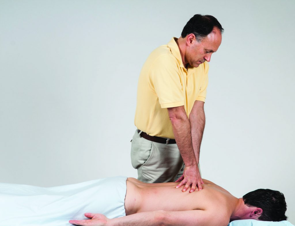 Massage stroke over the thoracic region. Permission Joseph E. Muscolino. Advanced Treatment Techniques for the Manual Therapist: Neck (Elsevier, 2013).