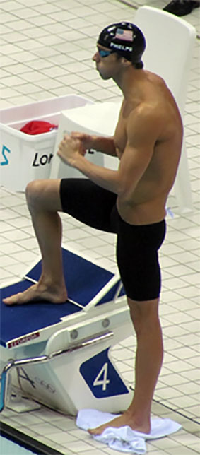 Michael Phelps and rounded shoulders and swimmer's shoulder.